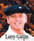 Larry Gatlin wearing a golf knickers, newsboy cap and argyle socks.